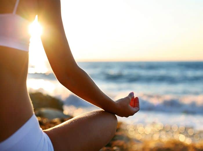 meditating woman while starting a personal retreat practicing mindfulness