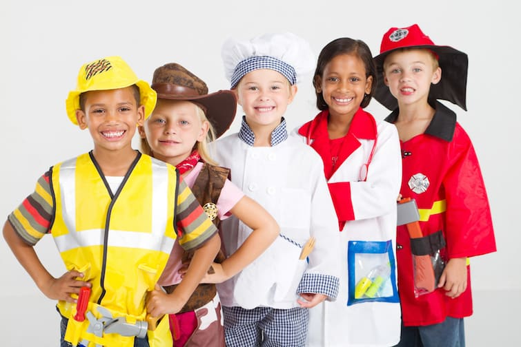 group of kids in uniforms costumes before they grow up