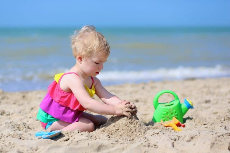 child on beach making sandcastle who might learn about failure