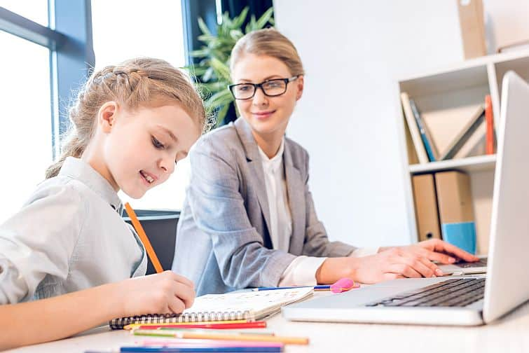 Daughter drawing with mother in office want your dream job