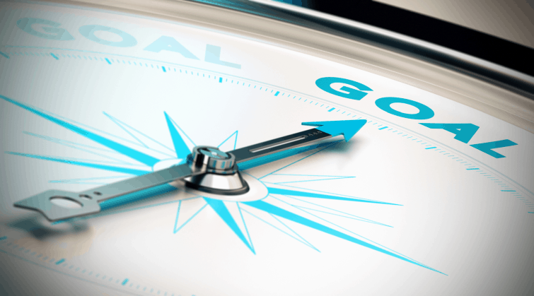 partial view of a compass pointing toward the word goal, depicting the culmination of smarter goals