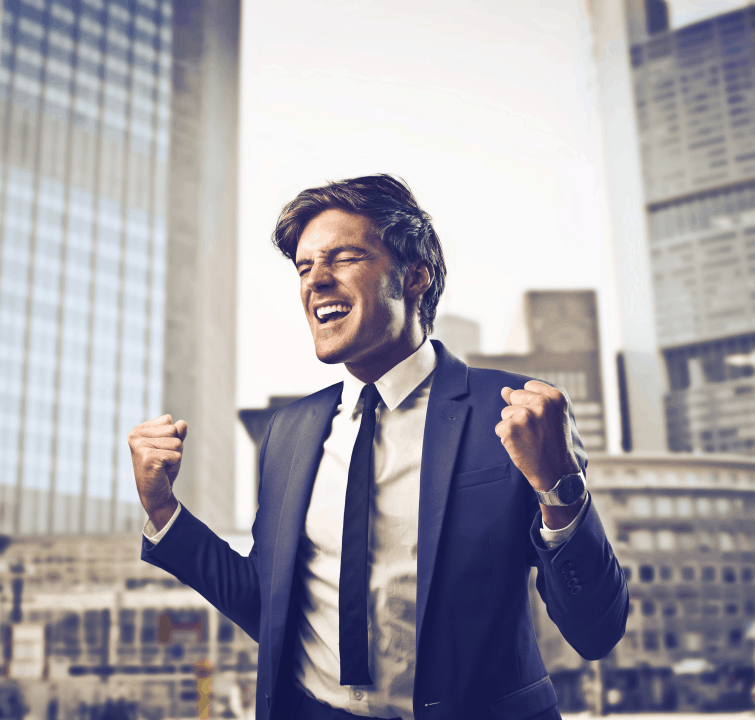 man in business suit celebrating his success in business
